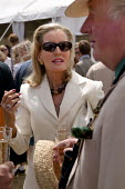 The wealthy enjoy a drink at The Veuve Clicquot Gold Cup Polo Final, Cowdray Park Polo Club. West Sussex. - Jess Hurd - 2000s,2003,ACE culture,AFFLUENCE,AFFLUENT,alcohol,Bourgeoisie,Champagne,CHAMPAIGN,class,club,clubs,drink,drinker,drinkers,drinking,drinks,elite,elitism,EQUALITY,FEMALE,glass,glasses,Gold,high,high inc
