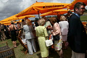 The wealthy enjoy a drink at The Veuve Clicquot Gold Cup Polo Final, Cowdray Park Polo Club. West Sussex. - Jess Hurd - 2000s,2003,ACE culture,AFFLUENCE,AFFLUENT,alcohol,Bourgeoisie,Champagne,CHAMPAIGN,class,club,clubs,drink,drinking,elite,elitism,EQUALITY,FEMALE,glass,glasses,Gold,high,high income,income,INCOMES,INEQU