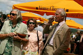 The wealthy enjoy a drink at The Veuve Clicquot Gold Cup Polo Final, Cowdray Park Polo Club. West Sussex. - Jess Hurd - 20-07-2003