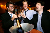 City businessmen celebrate over a glass of champagne in a posh Wine Bar. City of London. - Jess Hurd - 15-07-2003
