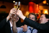 City businessmen celebrate over a glass of champagne in a posh Wine Bar. City of London. - Jess Hurd - 2000s,2003,AFFLUENCE,AFFLUENT,alcohol,arrogance,BANK,banker,bankers,BANKS,bonus,bonuses,bottle,bottles,Bourgeoisie,businessman,businessmen,CELEBRATE,celebrating,CELEBRATION,celebrations,champagne,CHAM