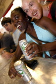 A couple buy drinks at the Workers Beer Comapany Stand, Millennium Dome Respect Festival. - Jess Hurd - 19-07-2003