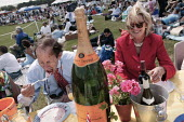 The wealthy enjoy a picnic at The Veuve Clicquot Gold Cup Polo Final, Cowdray Park Polo Club. West Sussex. - Jess Hurd - 2000s,2003,AFFLUENCE,AFFLUENT,alcohol,bottle,BOTTLES,Bourgeoisie,Champagne,CHAMPAIGN,class,club,clubs,drink,drinker,drinkers,drinking,drinks,eat,eating,eating food,elite,elitism,EQUALITY,FEMALE,food,F