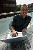 Gen sec Jeremy Dear on the roof of NUJ HQ. London. - Jess Hurd - 12-08-2003