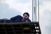 American magician David Blaine lies in a sealed perspex box suspended 40 feet in the air near Tower Bridge in London. He plans a feat of endurance, spending 44 days alone without food. - Jess Hurd - 06-09-2003