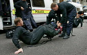 City of London and British Transport Police officers trained in chemical and biological defence remove their protection suits during an exercise simulating a chemical agent terrorist attack on Bank Un... - Jess Hurd - 06-09-2003
