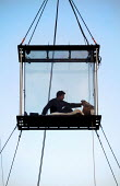 American magician David Blaine hangs in a sealed perspex box suspended 40 feet in the air near Tower Bridge in London. He plans a feat of endurance, spending 44 days alone without food. - Jess Hurd - 06-09-2003