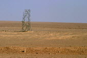 Electricity pylons destroyed by coalition forces during the invasion, on the road from Jordan to Baghdad, Iraq. - Jess Hurd - 05-10-2003
