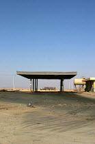 Iraqi oil tanker at a petrol station on the road from Jordan to Baghdad, Iraq. - Jess Hurd - , conflicts & war, Iraqis,2000s,2003,Arab,Arabs,ebf economy,filling station,highway,Iraqi,Jordan,Middle East,occupation,occupations,oil,petrochemical,petrol,road,ROADS,service station,station,STATIONS