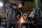 Working in a Bicycle factory. Baghdad, Iraq. - Jess Hurd - 06-10-2003