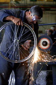 Woman working in a Bicycle factory. Baghdad, Iraq. - Jess Hurd - 06-10-2003