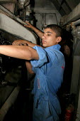 Young rail worker at Baghdad maintenance depot, Baghdad, Iraq. - Jess Hurd - , Iraqis,2000s,2003,Arab,Arabs,EBF,Economic,Economy,employee,employees,Employment,engineer,engineering,engineers,Iraqi,Iraqis,job,jobs,lbr,maintaining,Maintenance,Middle East,network,people,person,per