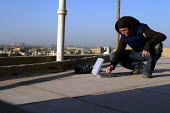Photographer Jess Hurd uses a satellite modem to send images from the roof of a building in Baghdad, Iraq - Jess Hurd - 07-10-2003