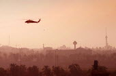 US military helicopter flies over Baghdad, Iraq. - Jess Hurd - 08-10-2003