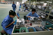 Chinese workers at the Feiyue Group Sewing machine factory. It is a privately owned industry on the outskirts of Jaojiang in the Taizhou Economic Development Zone, Zhejiang Province, China. - Jess Hurd - 26-10-2003
