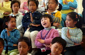 Chinese children sing in a music lesson. Children's Palace China Institute Welfare. A private school dedicated to the Arts and Science. Shanghai, China. - Jess Hurd - 2000s,2003,a,ace arts culture,CARE,carer,carers,CHILD,Child Care,childcare,CHILDHOOD,CHILDMINDING,children,China,Chinese,early years,edu education,education,INDEPENDENT,juvenile,juveniles,kid,kids,mel