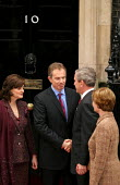 Tony Blair PM and Cherie meet with George Bush and his wife at No 10 Downing Street on the Presidents state visit to Britain. London Shaking hands. - Jess Hurd - 2000s,2003,America,hand,London,POL Politics,President,shake,Street,UK,US,USA
