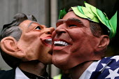 Protesters in Tony Blair PM and George Bush masks kissing. Stop the War demonstration against the Presidents state visit to Britain. - Jess Hurd - 20-11-2003
