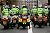 Police motorcyclists. High level police security operation as anti war protesters gather against the State visit of US President George Bush to the UK. - Jess Hurd - 20-11-2003