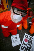 Protestors dressed as detainees at Camp Delta, Guantanamo Bay, campaigning to free the prisoners, American Embassy. Stop the War Coalition protest against the State visit of US President George Bush t... - Jess Hurd - 21-11-2003