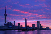 Sunrise over the Huangu River. View of Pudong financial district from the Bund. Shanghai, China. - Jess Hurd - 20-10-2003