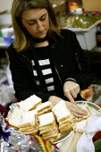 Local student and Volunteer makes turkey sandwiches for the homeless. Christmas Day night at the Newham Night shelter for the homeless, 170 Harold Road, East london. - Jess Hurd - 2000s,2003,charitable,charity,Christmas,cities,city,eat,eating,employee,employees,Employment,EQUALITY,europeregi,excluded,exclusion,female,food,FOODS,giving,HARDSHIP,help,helping,HELPS,highway,homeles