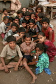 Street kids pose for a photograph in their shanty town home, Mumbai, India. - Jess Hurd - 23-01-2004