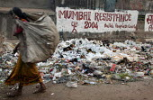 Women collecting rubbish for recycling, World Social Forum banner, Mumbai, India - Jess Hurd - 23-01-2004