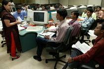 Training new recruits. Infowavz Call Centre, Mumbai India. - Jess Hurd - 23-01-2004