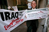 Demonstration against the corporate takeover of Iraq. Bechtel HQ, London. - Jess Hurd - 25-02-2004