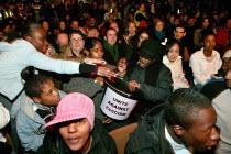 Collection at the Unite Against Fascism Launch Rally, London Astoria. - Jess Hurd - 2000s,2004,ACE culture & entertainment,activist,activists,Against,Anti Racism,BAME,BAMEs,bigotry,black,BME,bmes,CAMPAIGN,campaigner,campaigners,CAMPAIGNING,CAMPAIGNS,Collection,cultural,DEMONSTRATING,
