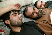 """Faroq, Fariborz and Mokhtar Iranian Kurdish Hunger Strikers protesting against deportation after their failed asylum application, Glasgow, Scotland. They have sewn up their mouths vowing """"they would r... - Jess Hurd - 01-03-2004"""