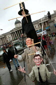 Puppeter with puppets of Tony Blair and George Bush. Stop the War demonstration marking the anniversary of war on Iraq. Trafalgar Square, London. - Jess Hurd - 20-03-2004