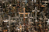 The Hill of Crosses. Tens of thousands of crucifixes fill the site which became a symbol of resistance against Soviet Occupation when the regime bulldozed the shrine and burnt the crosses. Kainas, Sia... - Jess Hurd - 01-05-2004