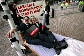 Tony Blair and the Dick Evans Chairman of BAE Systems cavort in a bed outside the BAE Systems AGM. Protest organised by Campaign against the Arms Trade. Queen Elizabeth II Conference Centre, London. - Jess Hurd - 05-05-2004
