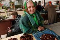 Woman sells wild mushrooms on a street market. Naujoji Vilnia, Lithuania. - Jess Hurd - ,2000s,2004,adult,adults,age,ageing population,EARNINGS,EBF Economy,elderly,EQUALITY,EU,Europe,european,europeans,eurozone,excluded,exclusion,female,HARDSHIP,impoverished,impoverishment,Income,INCOMES