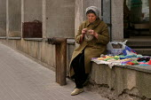 Woman knitting garments to sell on the street. Vilnius, Lithuania. - Jess Hurd - 03-05-2004