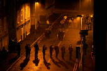Riot senario at Metropolitan Police Public Order Training Centre, Gravesend, Kent. - Jess Hurd - 2000s,2004,adult,adults,at,bomb,BOMBS,CLJ crime law,dark,darkness,disorder,equipment,fire,fires,gear,helmet,HELMETS,MATURE,night,officer,OFFICERS,Police,Police Officer,policing,Public,rebellion,revolt