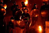 Metropolitan Police Public Order Training Centre, Gravesend, Kent. - Jess Hurd - ,2000s,2004,adult,adults,at,bomb,BOMBS,CLJ crime law,dark,darkness,disorder,equipment,fire,fires,gear,helmet,HELMETS,MATURE,Molotov Cocktails,night,officer,OFFICERS,Petrol Bomb,Police,Police Officer,p