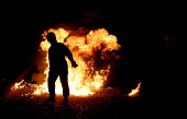 Riot senario at Metropolitan Police Public Order Training Centre, Gravesend, Kent. - Jess Hurd - 2000s,2004,adult,adults,at,bomb,BOMBS,CLJ crime law,dark,darkness,disorder,equipment,fire,fires,gear,helmet,HELMETS,MATURE,Molotov Cocktails,night,officer,OFFICERS,Petrol Bomb,Police,Police Officer,po