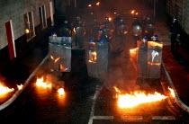 Riot senario at Metropolitan Police Public Order Training Centre, Gravesend, Kent. - Jess Hurd - 2000s,2004,adult,adults,at,bomb,BOMBS,CLJ crime law,cocktail,dark,darkness,disorder,equipment,fire,fires,gear,helmet,HELMETS,MATURE,Molotov Cocktails,night,officer,OFFICERS,Petrol Bomb,Police,Police O