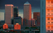 Canary Wharf at sunset. Docklands, East London. - Jess Hurd - 2000s,2004,ACE,AFFLUENCE,AFFLUENT,America,American,americans,architecture,arts,bank,banking,banks,blocks,Bourgeoisie,building,buildings,Canary Wharf,capitalism,capitalist,Citi,Citibank,cities,Citigrou