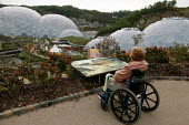 Disabled visitor views the Eden Project Geostatic Biomes. The Cornwall tourist attraction is worlds largest greenhouse and holds plants from across the globe. - Jess Hurd - 13-05-2004