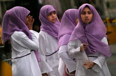 Young girls enjoy a fairground at the opening of The London Muslim Centre, East London. - Jess Hurd - 12-06-2004