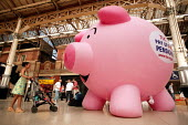 TUC Pay Up For Pensions campaign inflatable Piggy Bank at Victoria Station. London. - Jess Hurd - 16-06-2004