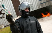 Police officer demonstrates the use of a petrol bomb at a Prime Training Solutions, Public Safety Awareness Course for journalists. Greater Manchester Police training facility, Claytonbrook Complex. G... - Jess Hurd - 22-06-2004