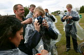 Journalists from the BBC and ABC prepare to experience the effects of CS Gas at a Prime Training Solutions, Public Safety Awareness Course. Greater Manchester Police training facility, Claytonbrook Co... - Jess Hurd - 2000s,2004,adult,adults,chemical,CHEMICALS,CLJ law,cs gas,disorder,exercise,exercises,gas,gas mask,gas masks,gasmask,gasmasks,irritant,journalism,journalist,journalists,lethal,Manchester,mask,masks,MA