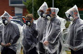Journalists from the BBC and ABC prepare to experience the effects of CS Gas at a Prime Training Solutions, Public Safety Awareness Course. Greater Manchester Police training facility, Claytonbrook Co... - Jess Hurd - 2000s,2004,adult,adults,chemical,CHEMICALS,CLJ law,cs gas,disorder,exercise,exercises,gas,irritant,journalism,journalist,journalists,lethal,Manchester,MATURE,media,non,OC,pain,painful,pepper,police,po