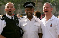Gay MET police officers, PC Graham Alldus, PC Gamal Turawa and DAC Brian Paddick. Gay Pride London Rally, Trafalgar Square. - Jess Hurd - 03-07-2004