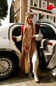 The bridegroom arrives in a limousine at the Suleymanie Mosque for a traditional arranged Wedding and Walima ceremony. Dalston, East London. - Jess Hurd - 01-08-2004